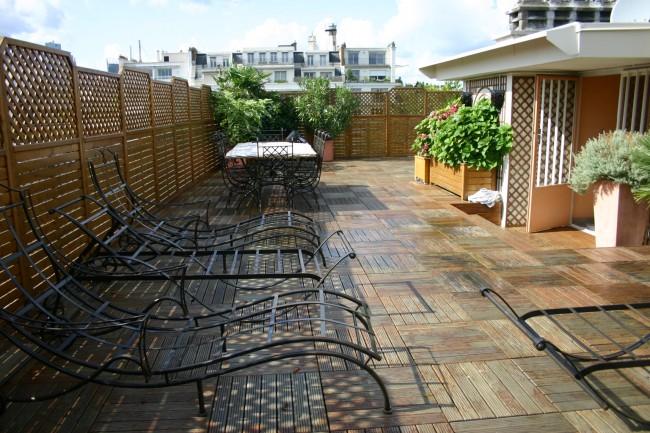 Une création realisée par amenagement terrasses pour une terrasse unique et sur-mesure